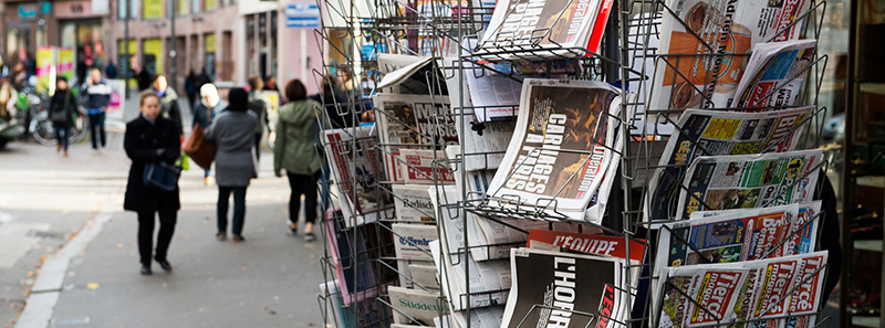 Newspaper stand in a Europaen city with terror related news on the frontpages