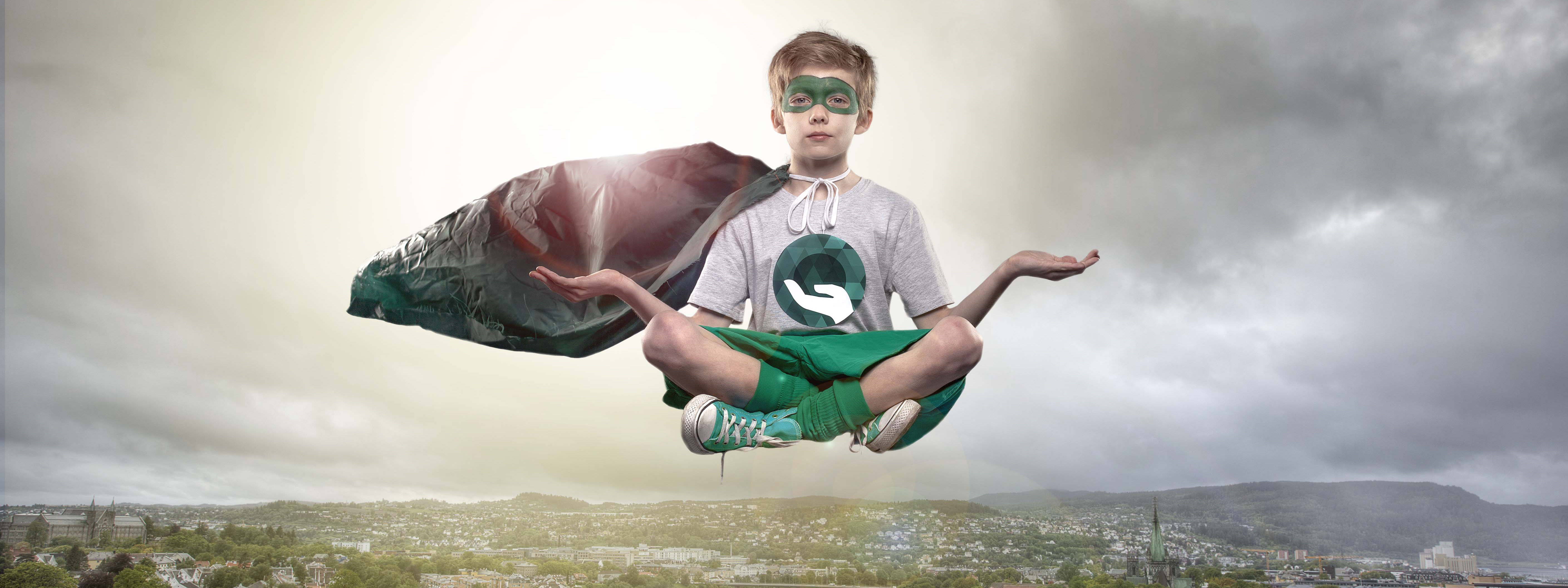 Green superhero over the city. Photo.