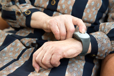 Elderly woman with emergency call system