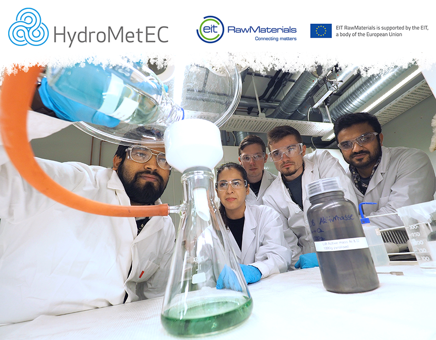 HydroMetEC, eit and European union logos and underneath, a photo with researchers in the lab with experiment. Logos and photo