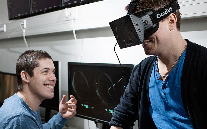 Two students testing Oculus virtual reality