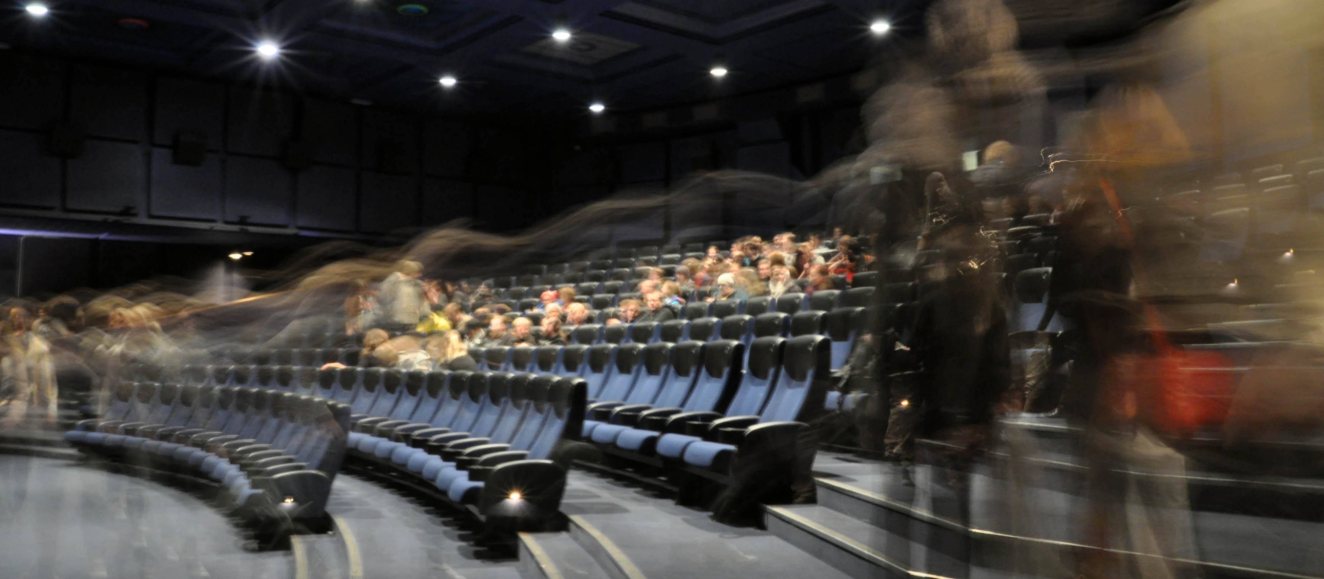 People in a cinema theatre. Photo.