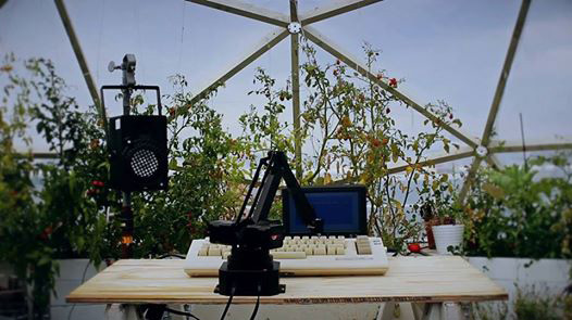 Speaker, microphone and a computer on a table in a garden