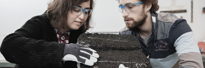 Photo. Two researchers working in asphalt lab.