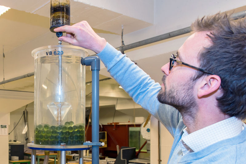 Photo. Researcher working in Water and Wastewater lab.