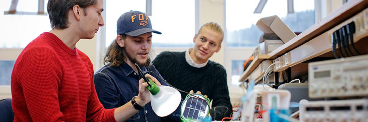 Picture of students with solar panel equipment