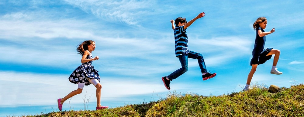 Children running on a hill. Photo: iStock