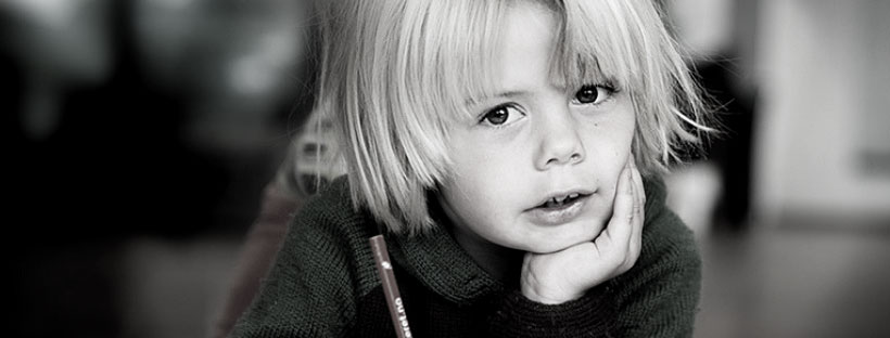 Kid writing with pencil. photo