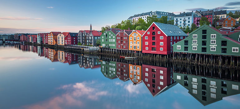 picture shows the old wharves by the Nidelven river in Trondheim