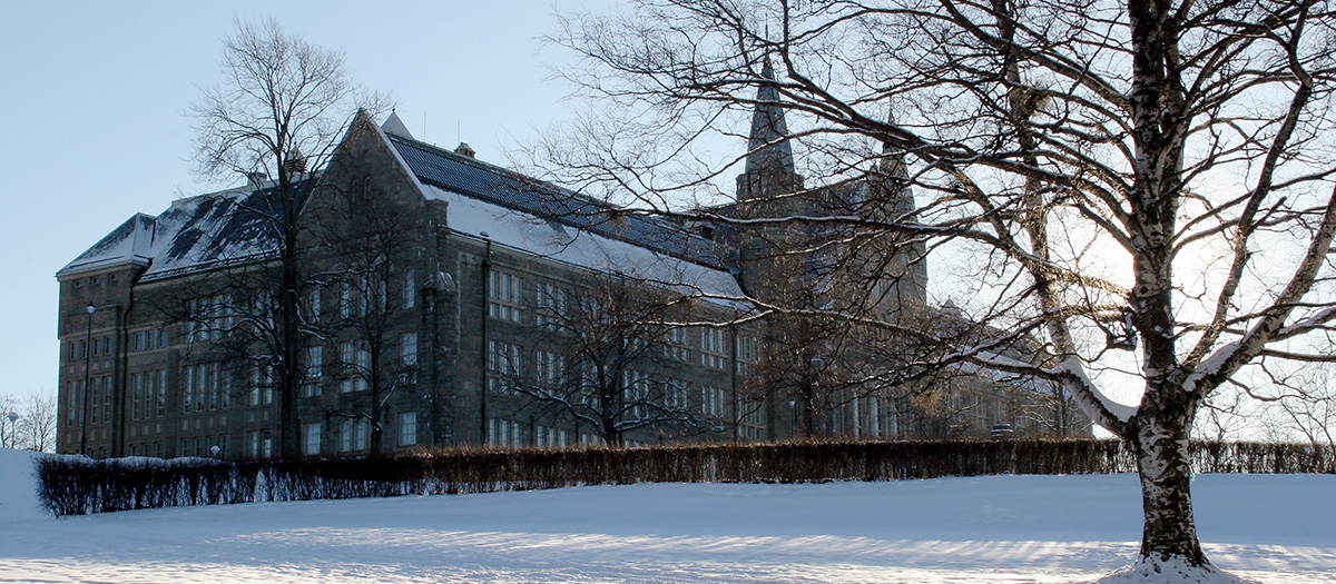 University stone building on a snowy winter's day