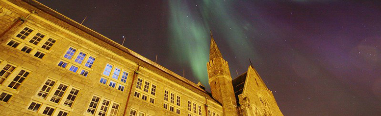 Northern lightning and main building at Gløshaugen. Photo