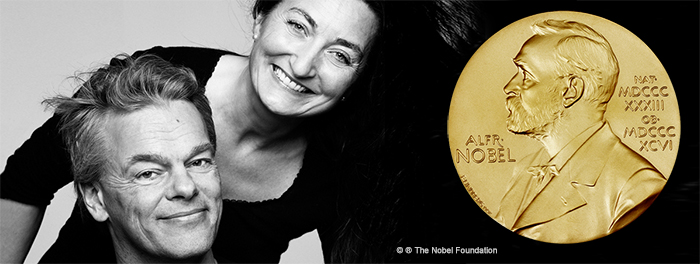 May-Britt and Edvard Moser and Alfred Nobel gold medal. Photo.