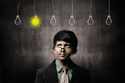 A boy with glasses and light bulbs