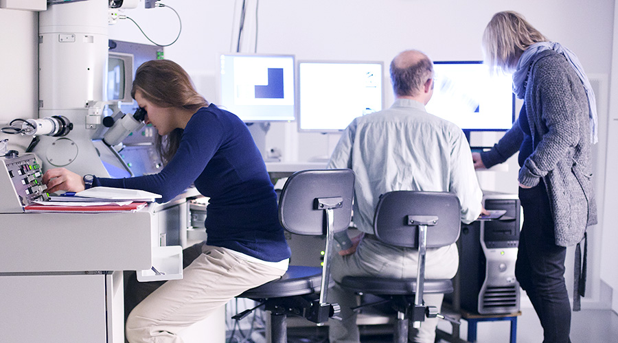 Researchers in the TEM lab