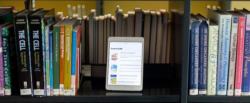 Close up of book shelves with ipad