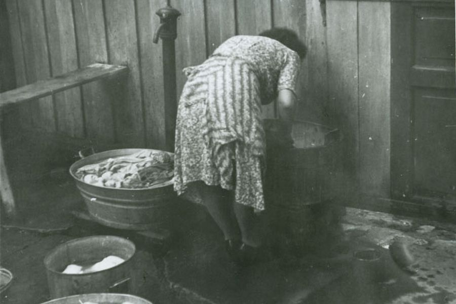 Woman washing clothes in the backyard, Trondheim, early 1950's