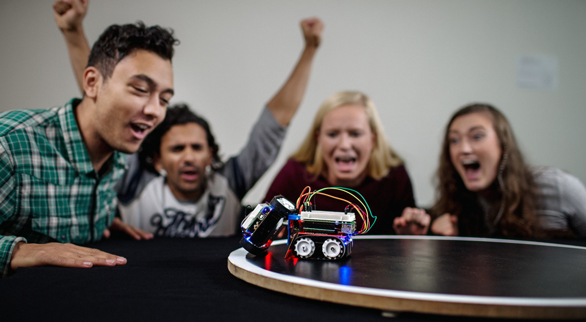 Students with sumo robot. Photo