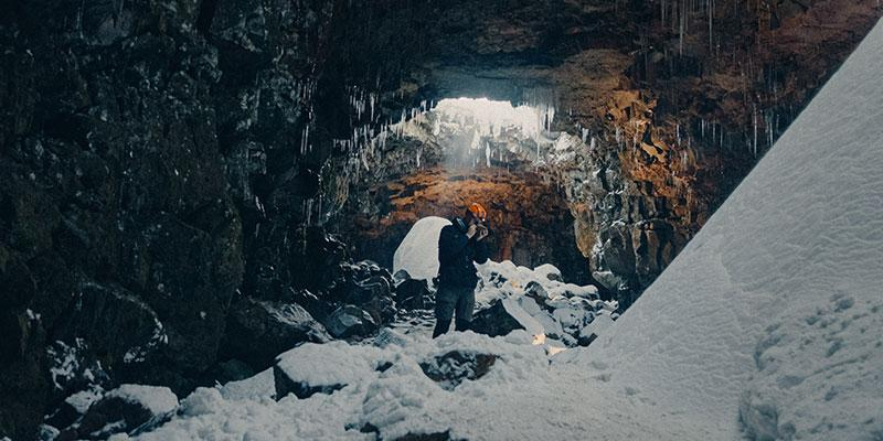 A man photographing inside a cave