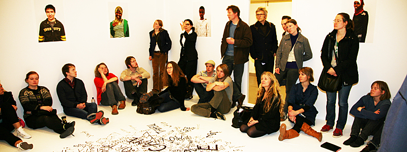 Picture of students and teachers gathered in a studio.