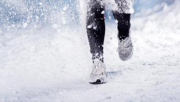 Jogging on snow. Photo.
