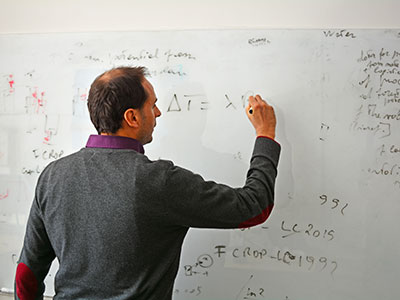 Lecturer writing on a whiteboard. Photo: NTNU/Lars R. Bang