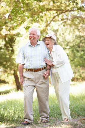 Elderly couple walking and laughing