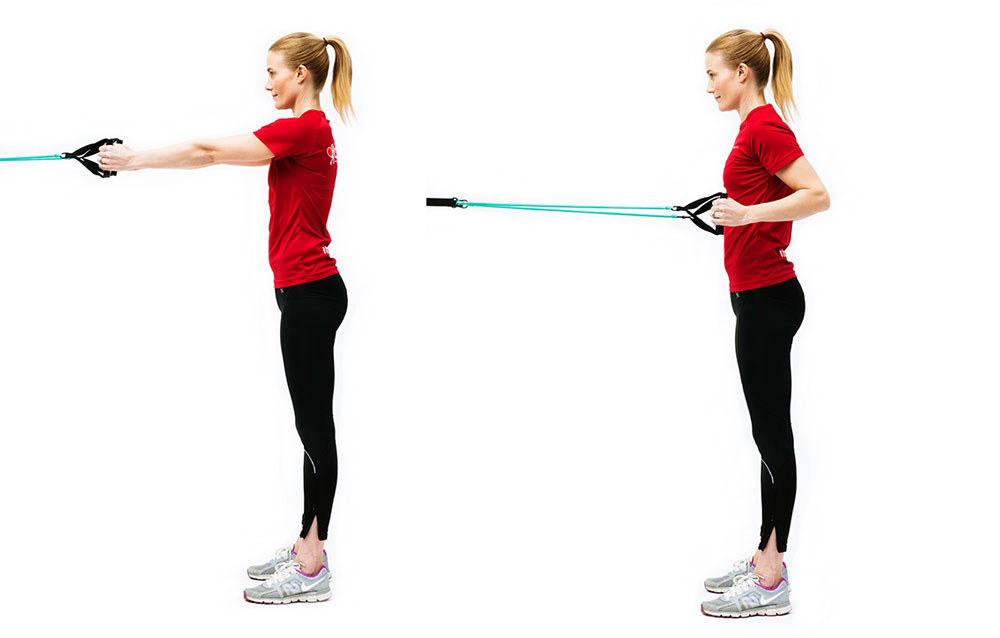 Woman doing standing rowing with elastic band