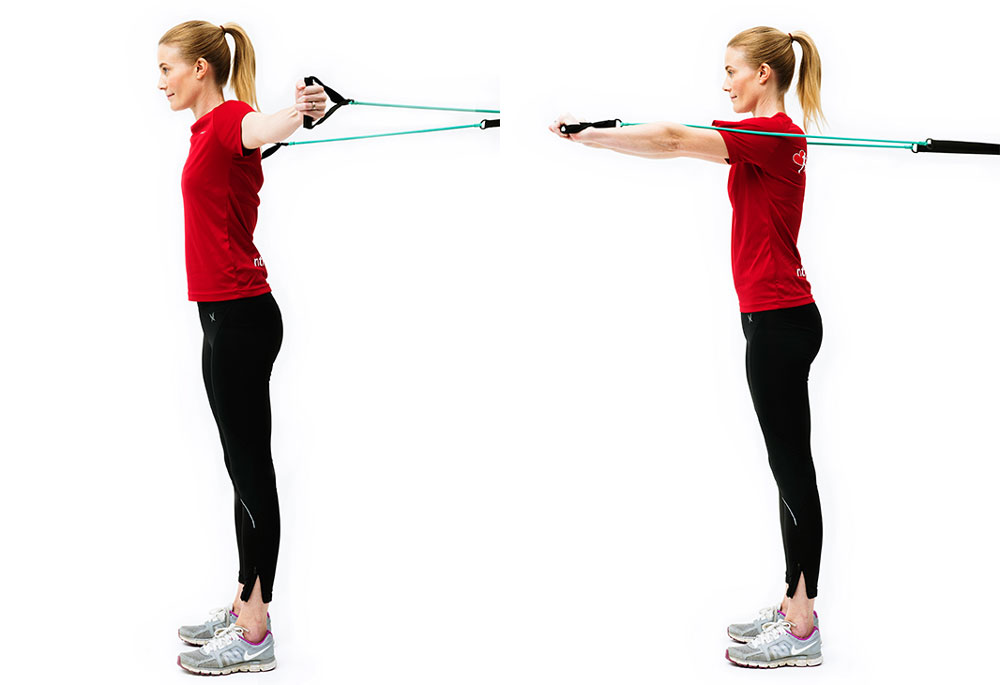 Woman doing standing arm-press