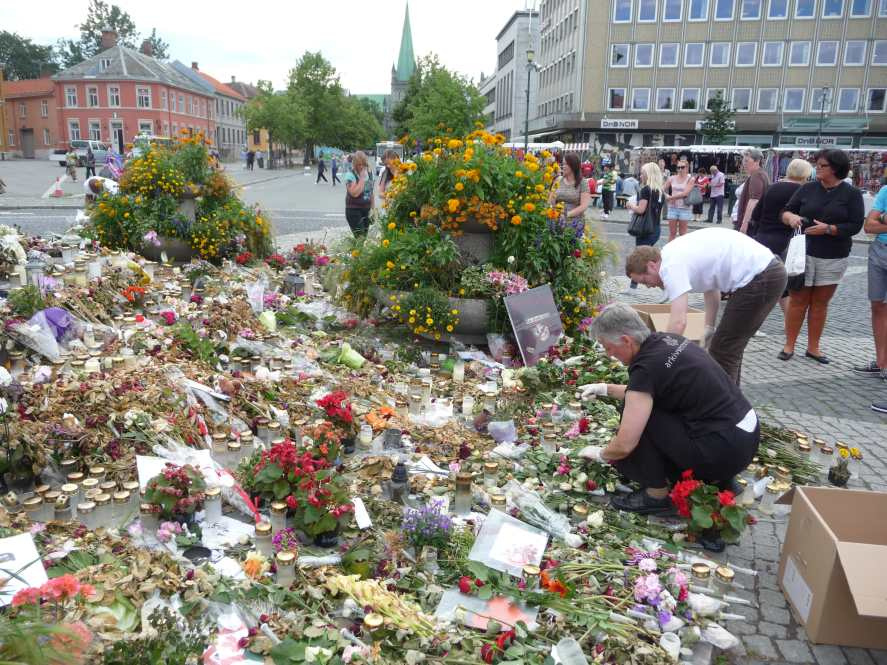 Objects from a temporary memorial being collected by staff members from the State Archives in Trondheim, August 5 2011.